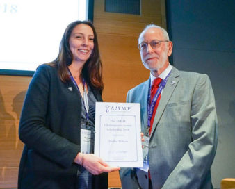 AMMF's Harry Corrigan presenting the first AMMF Cholangiocarcinoma Scholarship to Mollie Wilson